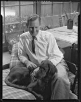 Paul Sample in his studio with his dog, Pasadena, circa 1935