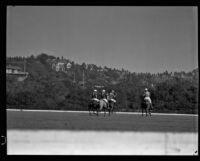 Raymond Griffith, Darryl Zanuck, Lucian Hubbard and Dave Whyte playing polo, Los Angeles, 1931