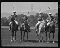 Dave Whyte, Darryl Zanuck, Lucian Hubbard and Raymond Griffith posing on their polo horses, Los Angeles, 1931