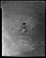 William J. Conselman in a swimming pool at the William Conselman Residence, Eagle Rock, 1930-1939