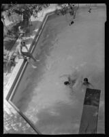 William Conselman watching his children, Deirdre and William, in their swimming pool, Eagle Rock, 1930-1939