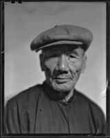 Asian-looking man, probably in Will Connell's photography studio, 1930-1960