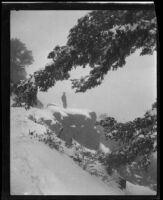 Man in snow-covered landscape, circa 1920