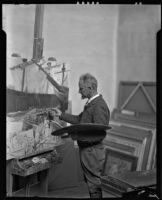Carlos Vierra working on a painting in his studio, Santa Fe, 1932