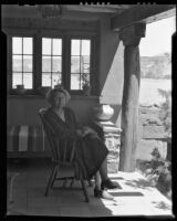 Alice Corbin Henderson seated on her back porch, Santa Fe, 1932