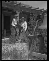 William Penhallow Henderson and Alice Corbin Henderson outside their house, Santa Fe, 1932