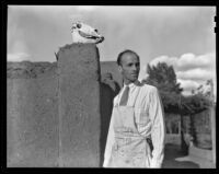 "Walter Willard ""Spud"" Johnson standing next to a Pueblo Revival building, Santa Fe or Taos, 1932"