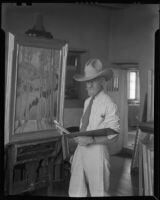 Sheldon Parsons working on a painting in his studio home, Santa Fe, 1932
