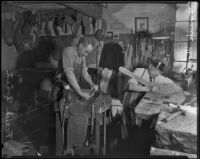 Frank Conen and Frank Moreno at work in their saddlery, Southern California, ca. 1936