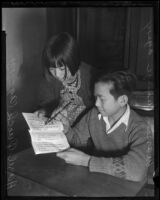 Hazel Quock and Warren Wong work on their Chinese lesson at the Chung Wah public school in Chinatown, Los Angeles, 1936