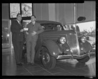 Bill Froelich presents new car to Times Contest winner Harry Ackelson, Los Angeles, 1936