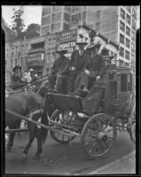 Governor Merriam, Governor Allred, and Buck Jones ride a horse drawn carriage, Los Angeles, 1936