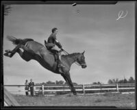 "James A. Gough and horse ""Judith"" clear a hurdle at the Flintridge Riding Club, Flintridge, 1936"