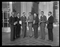 Winners of the March of Progress Realty Sales contest William G. Dickinson, Fred B. Palmer, H. Gordon Moore, B. W. Tye, John A. Ash and Edward J. Partridge given out by the Times' own Mr. Norman Chandler, center, Los Angeles, 1936