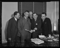 Percy V. Hammon, Robert P. Stewart, Eugene Williams, and Willard W. Burgess congratulate Buron Fitts on trial success, Los Angeles, 1936