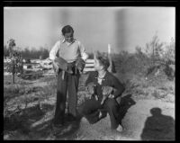Two unidentified young men with piglets, Los Angeles County, 1935