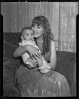 Carmen Saucedo holds her two month old daughter, Los Angeles, 1936