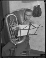 Boxer Wally Hall playing his tuba, Los Angeles, 1936