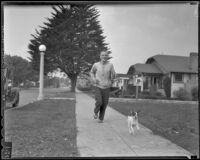 Boxer Wally Hall goes for a run with his dog Queen, Los Angeles, 1936