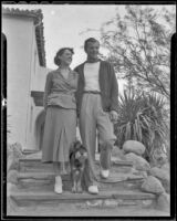 Herman Brix (Bruce Bennett) and his wife, Jeanette walk their dog while on vacation, Palm Springs, 1936