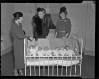 Mrs. Whitney Williams, Mrs. Gil McHaffie, and Mrs. Hilton McCabe with six babies in a crib, Los Angeles, 1936