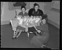 Mrs. Whitney Williams, Mrs. Gil McHaffie, and Mrs. Hilton McCabe sit with six babies, Los Angeles, 1936