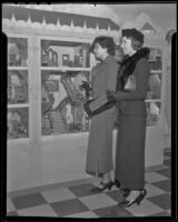 Mrs. George Rufus Smith and Edith Marshutz look at display, Los Angeles, ca. 1936