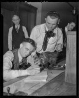 Al Horton and Leo McDonald with the wandering possum, Los Angeles, 1936