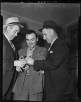 "Detective Lieutenant G. W. Cooke, William J. ""Curley"" Guy, and Det. Lt. A. C. Candy, Glendale, 1938"
