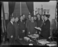 A. W. Koehl, Charles J. Correll, F. L. Duncan, O. D. McKenzie, W. D. Crook, Judge Rey Schauer, Warren E. Carey, and Claude Morgan are inducted by Sheriff Gene Biscailuz, Los Angeles, 1938