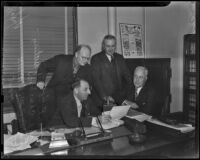 Buron Fitts, Eugene Williams, John W. Hart, and Ray L. Chesebro in Fitts' office, Los Angeles, 1938
