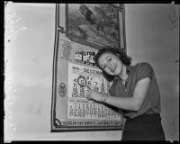 Jane Blair points to day after which taxes become delinquent, Los Angeles, 1938