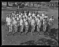 Members of the Junior Police Bicycle Corps pose with their bikes, Inglewood, 1938