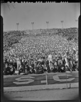 Spectators at the football game between USC and Notre Dame at the Coliseum, Los Angeles, 1938