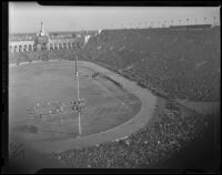 Partial image of the crowd during a Notre Dame vs. USC game at the Coliseum, Los Angeles, 1938