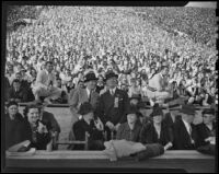 Rufus von KleinSmid enjoys the football game between USC and Notre Dame at the Coliseum, Los Angeles, 1938