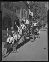 School children go down a slide, Los Angeles, 1938