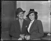 Theatrical agent, Walter Kane and actress, Lynn Bari who were filing for a marriage license, Los Angeles, 1938