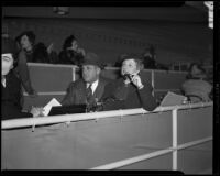 Horse race spectators in a box seating area at Santa Anita Park, Arcadia, 1938 or 1939