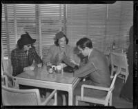 Mrs. Richard Hyde, Manuela Hudson Vanderbilt and Alfred Gwynne Vanderbilt at the Santa Anita Park Turf Club, Arcadia, 1938