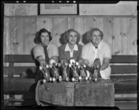 """Adele Curran, Elizabeth """"Betty"""" Campbell, and Mrs. Richard Harris show off their skates, Culver City, 1938"""