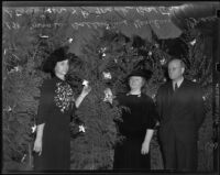 Mrs. W. Ballentine Henley, Grace S. Stoermer, and Dr. Frank Baxter with Christmas trees, Los Angeles, 1938