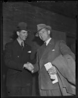 Elmer Layden and James Duval Phelan shake hands after Washington defeats Notre Dame, Los Angeles, 1938