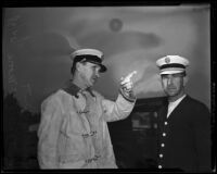 Fire Chief Ralph J. Scott and Assistant Fire Chief F. W. Moore respond to canyon fires, Los Angeles, 1938