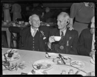 Civil War veterans Eugene Merrick and F. H. Crafts enjoy Christmas dinner at Patriotic Hall, Los Angeles, 1938