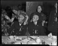 Civil War veterans John W. Harkrider and Joseph S. Detweiler enjoy Christmas dinner with their daughters, Los Angeles, 1938