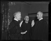 Marshall McComb sworn in while Judges Charles McCrail and Walton Wood witness, Los Angeles, 1938