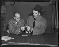 Ray Pinker and Lloyd Hurst inspect evidence from William Spinelli case, Los Angeles, 1938