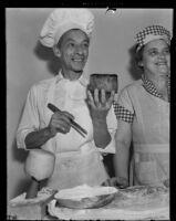 Cyril Delevanti and Eva Kitty Peel bake bread, Los Angeles, 1939
