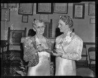 Mae Cushman presents Effie Mabel Fletcher with her new position in the American Gold Star Mothers, Los Angeles, 1939